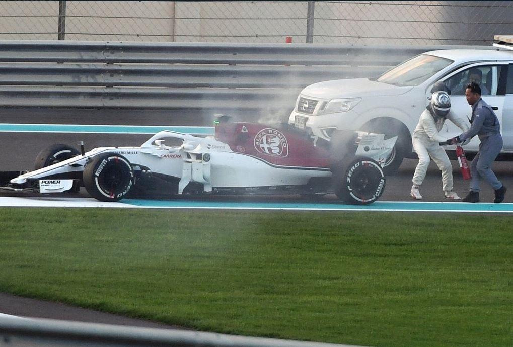 Kimi Raikkonen Using Fire Extinguisher After His Sauber Caught Fire