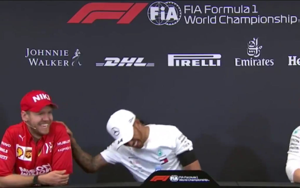 Sebastian Vettel And Lewis Hamilton Having Fun During Press Conference