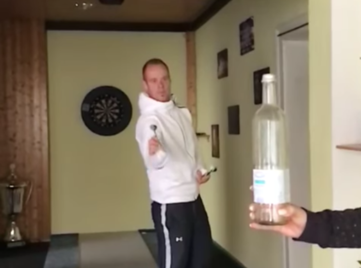 Max Hopp Does The Bottle Cap Challenge With His Darts