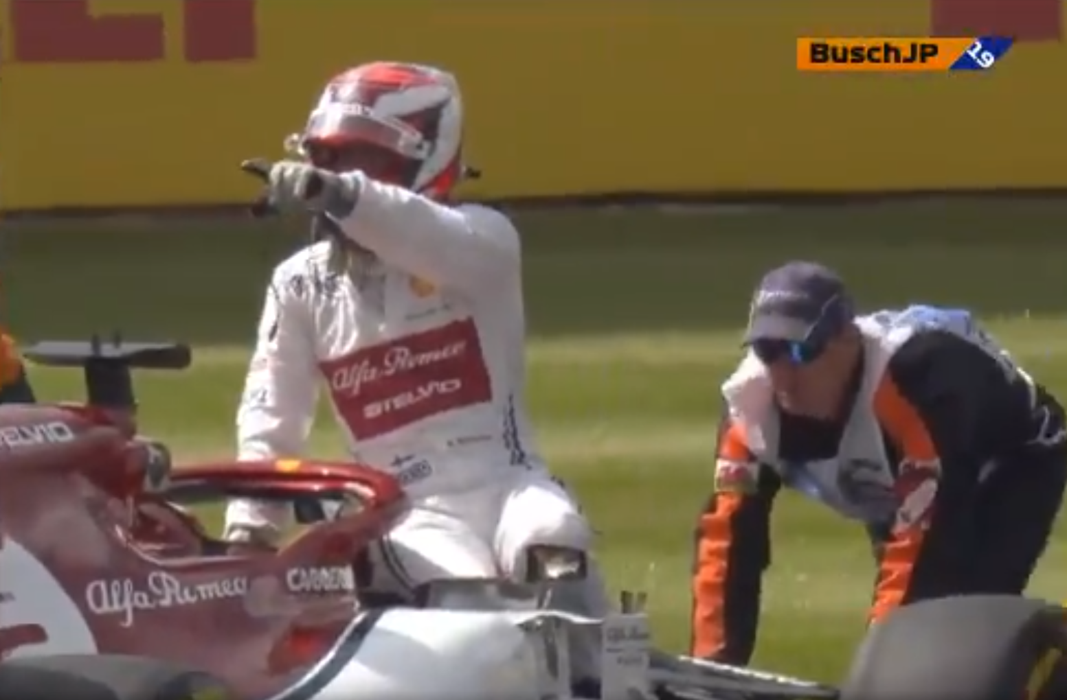 Kimi Raikkonen Sits On His Alfa Romeo While Getting Pushed by Marshals