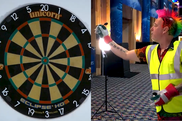 Peter Wright Plays A Game Of Darts With Heavy Duty Gloves